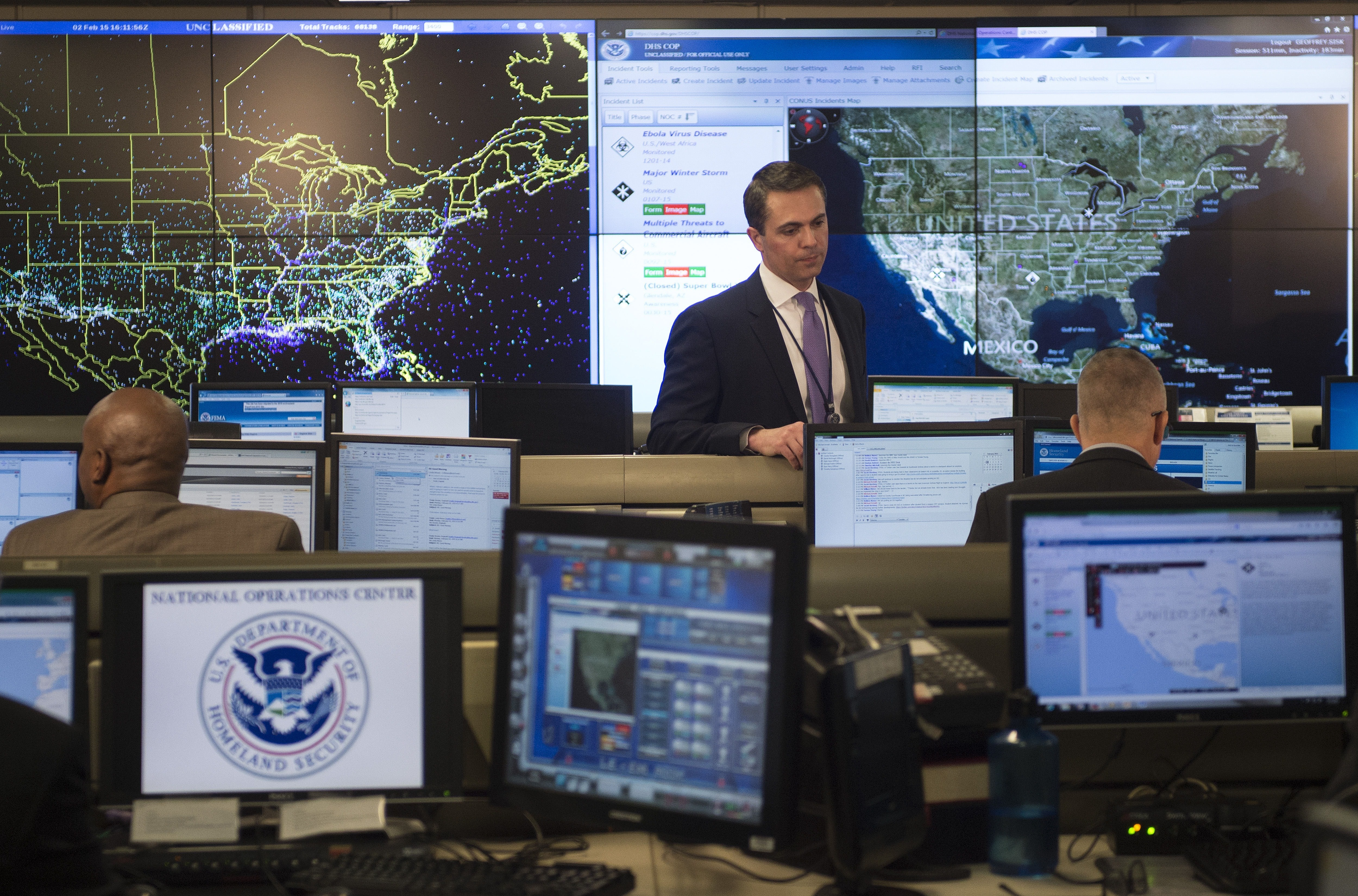 An employee sits at his computer terminal within the National Operations Center (NOC) at the Department of Homeland Security in Washington, DC, February 2, 2015.    AFP PHOTO/JIM WATSON        (Photo credit should read JIM WATSON/AFP/Getty Images)