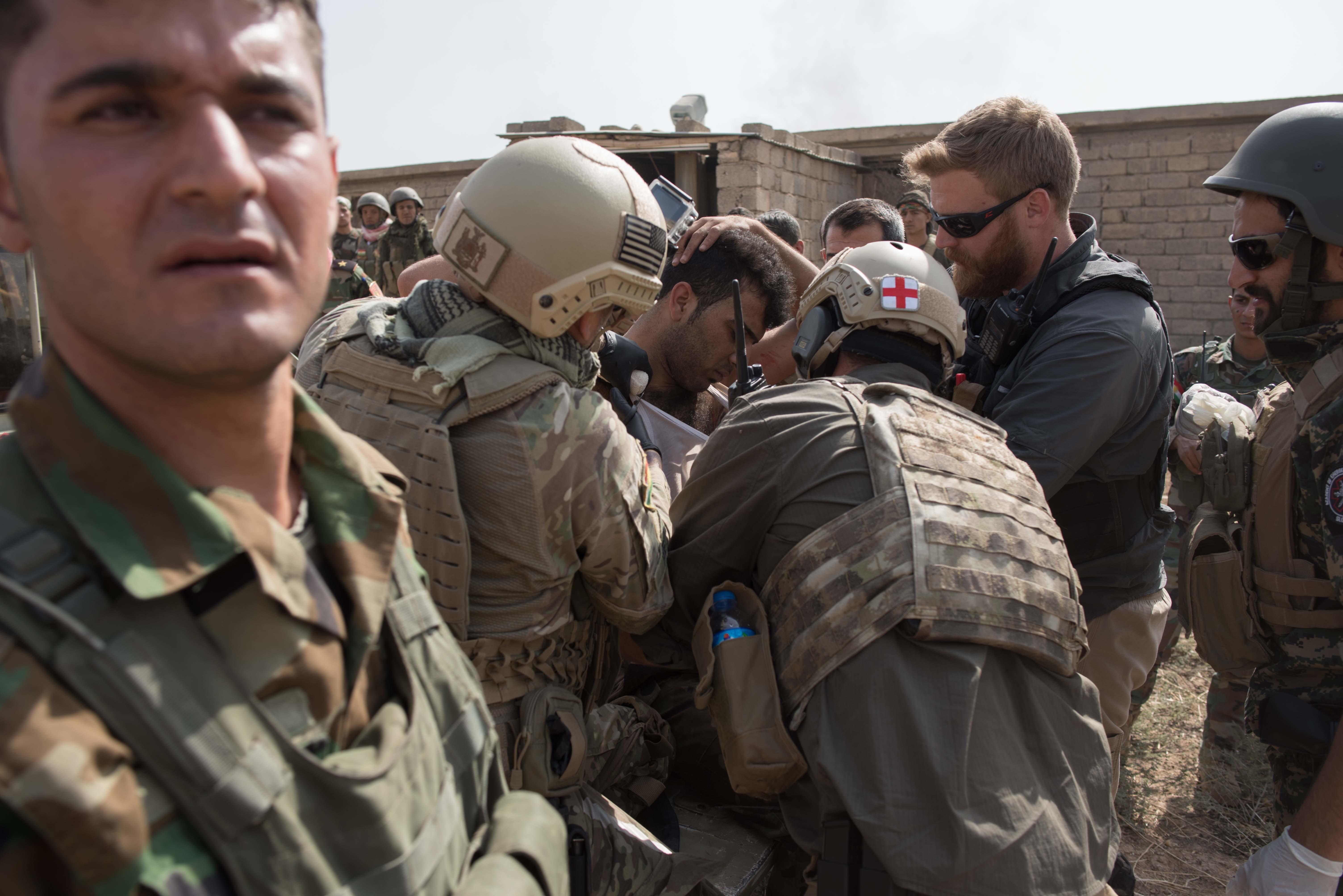American volunteer medics treating a wounded Kurdish fighter in Shahkoli on Monday 17 October 2016