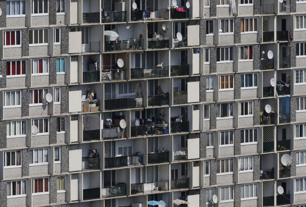 Apartments are seen in a high-rise block in Choisy-le-Roi, a suburb of Paris July 22, 2013. Staunchly secular France has long struggled to assimilate a Muslim population made up largely of descendants of immigrants from ex-colonies, that has grown to around 5 million people and itself feels shut out of mainstream society and the job market. The previous conservative government banned full-face veils in public and far-right politicians have complained about Muslim prayers spilling out onto streets from overcrowded mosques. Anti-Muslim incidents have risen steadily in recent years in France, home to Europe's largest Islamic minority, according to the Committee against Islamophobia in France (CCIF). Picture taken July 22, 2013. REUTERS/Youssef Boudlal (FRANCE - Tags: POLITICS SOCIETY IMMIGRATION)  ATTENTION EDITORS: PICTURE 02 OF 28 FOR PACKAGE 'LIVING AS A MUSLIM IN PARIS'. SEARCH 'ISLAM BOUDLAL' FOR ALL IMAGES - RTX12M55